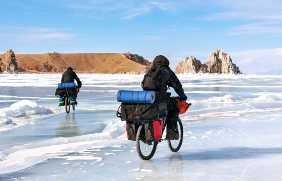 travelers on bicycles in winter at Lake Baikal